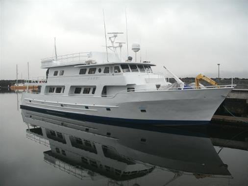 Custom Halter Conversion Motor Yacht At Dock In Seattle