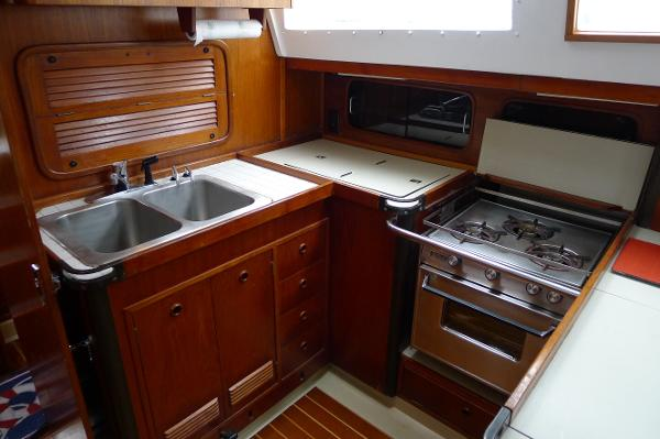 Galley with Propane Stove, Refrigeration, plenty of counter space & storage