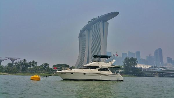 Princess 360 Flybridge Anchored below Sands Hotel