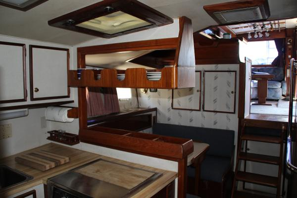Gally facing Convertible Dinette up towards Wet Bar