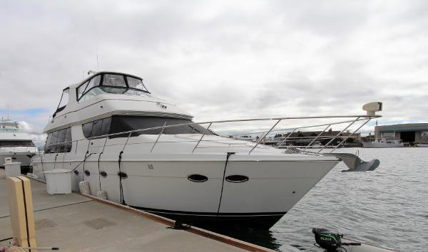 Carver 570 Voyager Pilothouse Profile at the dock