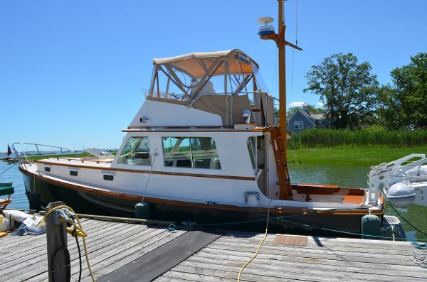 Jarvis Newman Custom Flybridge Cruiser At Her Dock, Showing Full Enclosure