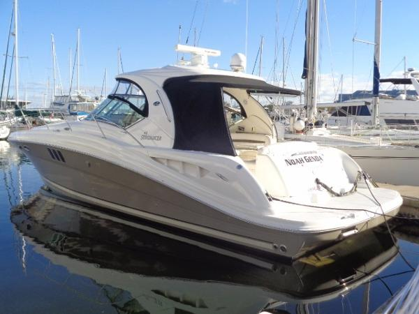 Sea Ray 44 Sundancer Port side view at dock