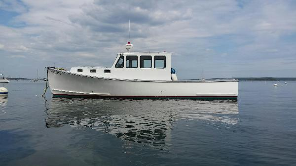 Duffy Hardtop Cruiser Side View On Her Mooring