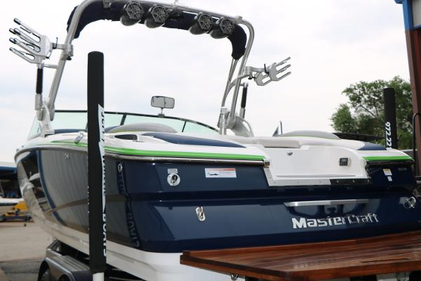 Ilmor MV8 6.2L 400hp w/ 79 hours,ONE YEAR MOTOR WARRANTY IF PURCHASED BEFORE APRIL 30TH, custom boat cover,  pull up cleats, bow ladder, filler cushion, ski mirrior, porta pottie w/. sink, walk through transom, three built-in water ballast, walk through door, Clarion am fm Bluetooth aft remote amp & sub, flip up bolster seat, wakeboard tower w/ racks, four JL Audio tower speakers, extended swim platform, bimini top and NEW Roadmaster tandem axle brakes & swing away tongue. Bank financing : $7000 Down 180 months @ $634. Ask for Gary Jackson