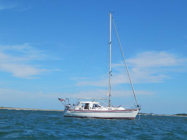Bootsbeau Vilm , Nauticat, Fisher 116 Motorsailer Pilothouse Starboard Side at Anchor
