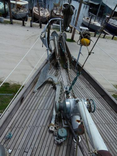A view of the bow with the windlass, club boom gooseneck area and bow Pulpit.