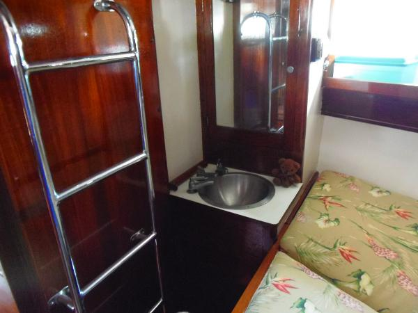 The king size berth also has its' vanity and easy access to the forward deck.