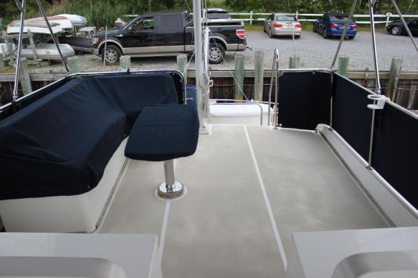 Canvas on Flybridge L seating w/teak table