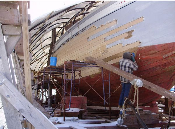 View forward starboard quarter plank work