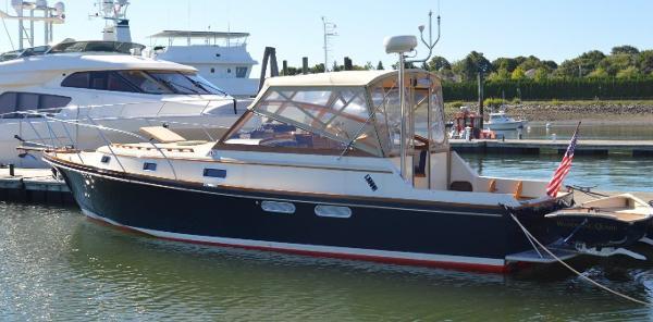 Little Harbor Custom 34 Express Cruiser With Propeller Drives Alongside