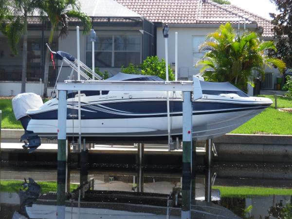 Hurricane 2400 Sun Deck OB Accross Canal Starboard