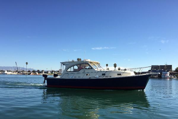 Mainship 34 Pilot Sedan Rum Runner Ii Cielito
