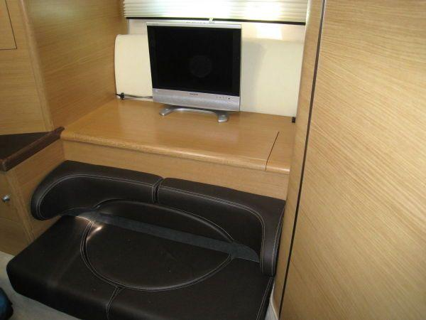 TV and couch in Stateroom