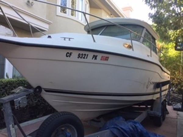 Seaswirl Striper 2600 Sport Cabin Pilothouse Portside Bow w/ Boat on Trailer