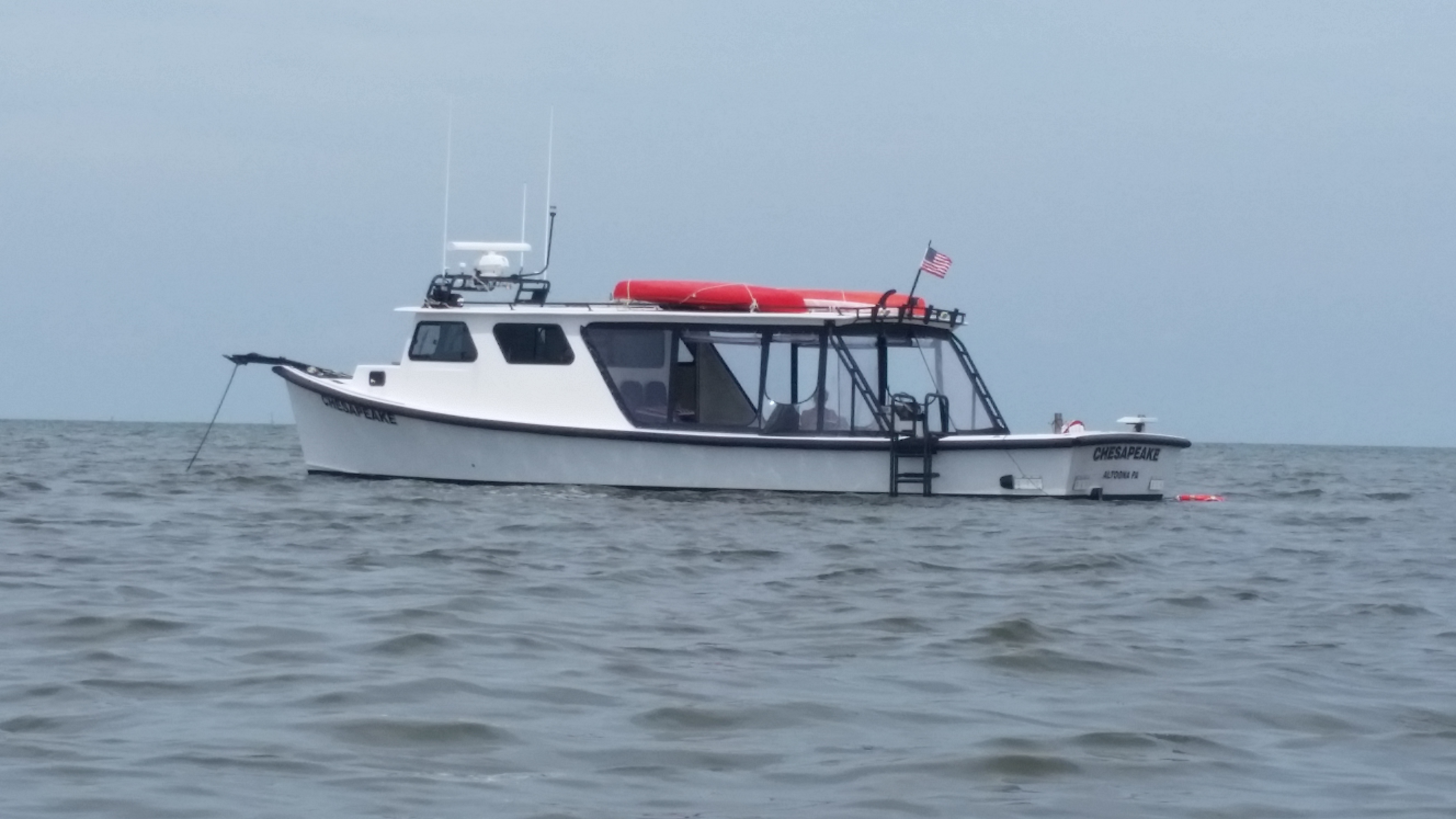 "Chesapeake Fiberglass Deadrise/Pilothouse 39 Chesapeake Bay Deadrise, ""Chesapeake"", at anchor"