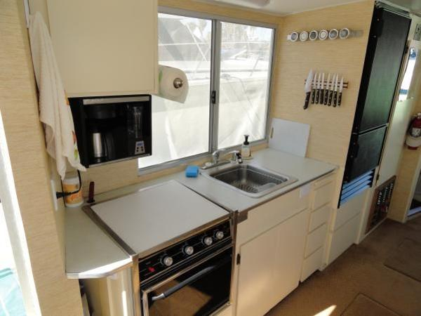 Galley with stove/oven, microwave, stainless sink and Nova Cool full size refrigerator/freezer