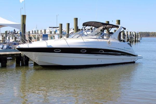 Larson Cabrio 330 Mid Cabin Port Side at dock