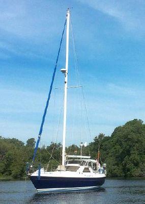 Tanzer 10.5 Pilothouse sloop At Anchor