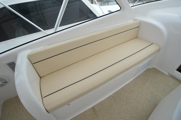Side bench seats, helm, port