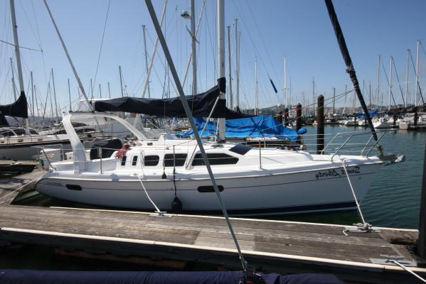 Hunter 310 Lying in potentially transferable Sausalito YH slip (photo taken befoer new dodger installed)