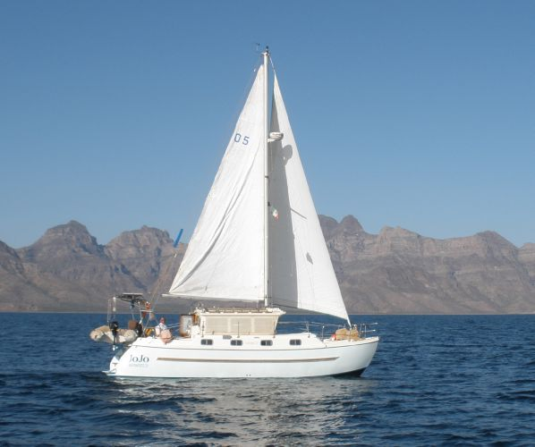 Fisher Pilothouse Catamaran Under Sail
