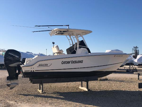 Boston Whaler Outrage SIDE VIEW WITH OUTRIGGERS