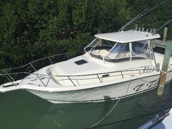 Pursuit 3070 Offshore Profile in water