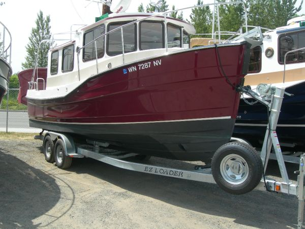 Ranger Tugs R25 2007 Ranger R25 Claret Red with Galvanized EZ loader trailer.