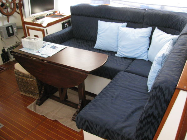 Salon settee and table aft of lower helm