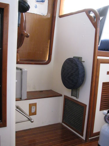 Lower helm folding seat and starboard door