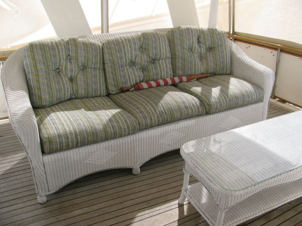 Large sundeck with wicker sofa and table