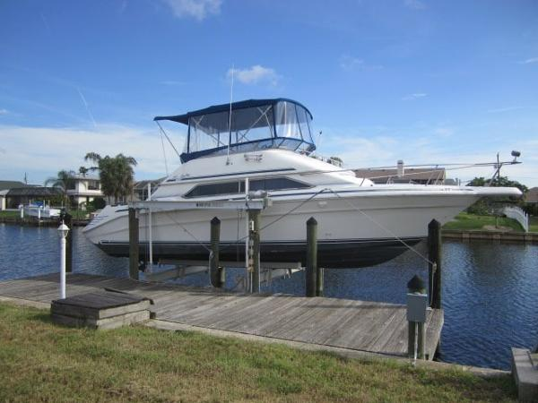 Sea Ray 350 Express Cruiser SECURE ON THE LIFT