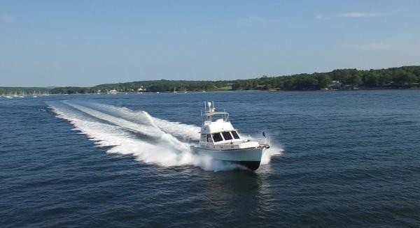 Eastbay 54 Flybridge Custom C. Raymond Hunt Assoc. 57- Chaos -  Underway