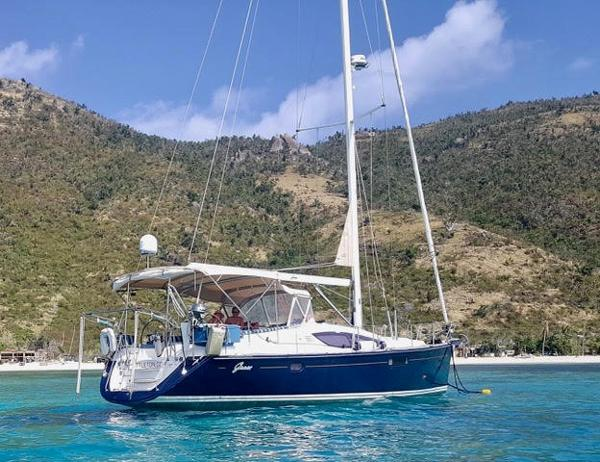 Jeanneau 45 Deck Salon Grace at Anchor at Jost Van Dyke with her new Flag Blue Topsides