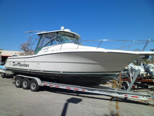 Pursuit 3070 Offshore Center Console STARBOARD ON TRAILER