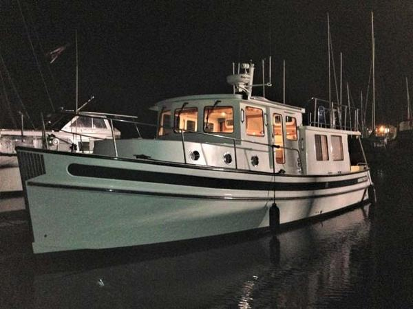 Nordic Tugs 37 Docked at night time