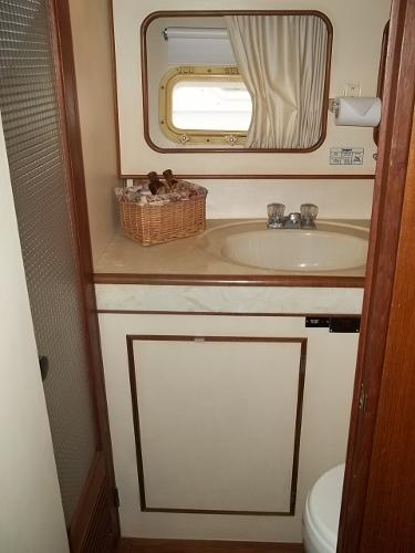 Guest stateroom ensuite head w/ shower and VacuFlush toilet
