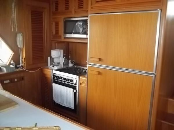 Galley with over sized fridge, propane cooking