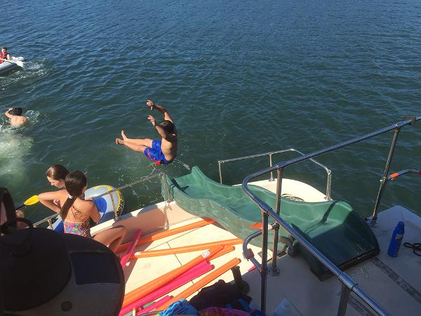 Holiday Mansion Coastal Commander Houseboat Slide deployed off top deck