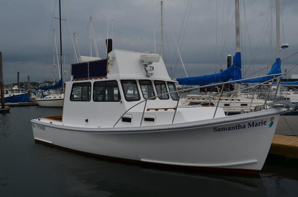 Seaworthy Flybridge Cruiser In Her Slip