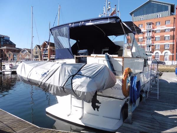 Sea Coral 425 Stern view, davits and tender.