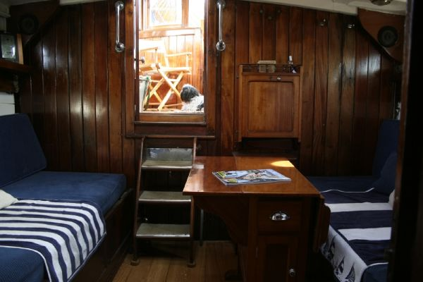 Cabin berth, drop leaf table and exit