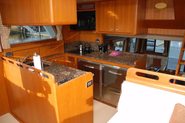 30A. Galley - Light honey tone teak interior.