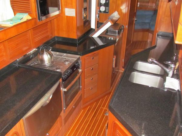 Galley looking aft, black granite countertops