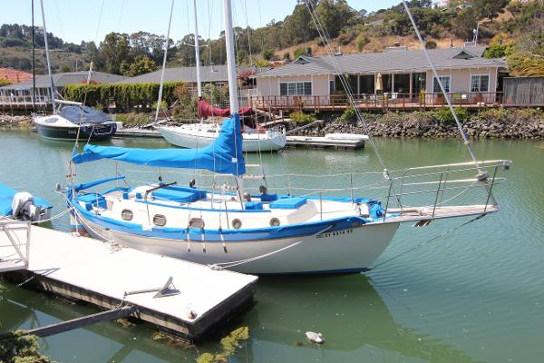 Westsail Cutter Lying behind owner's home as she has for over 40 years