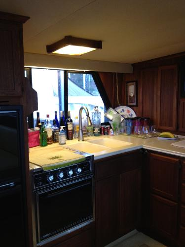 Full Galley Up with Corian Countertops and full sized refrigerator