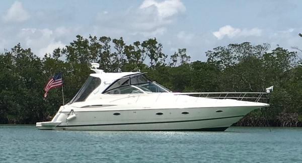 Cruisers Yachts 3970 Express Hardtop Starboard Side At Anchor
