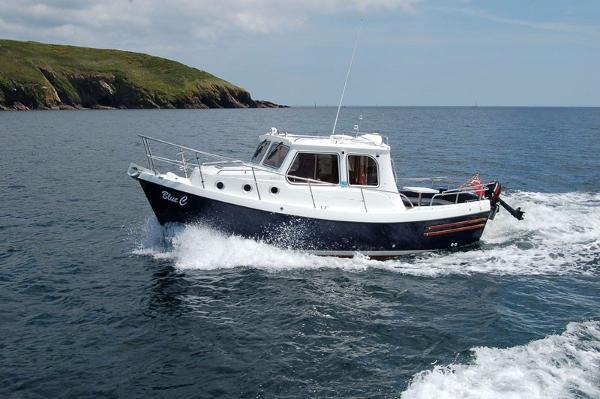 Trusty T 23 Motor launch. At sea, similar craft.