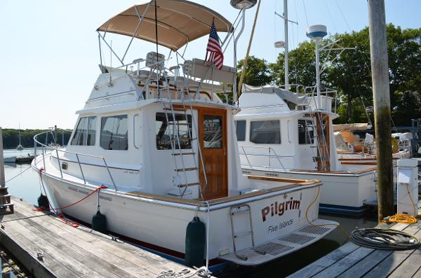 Cape Dory Flybridge Cruiser In Her Slip